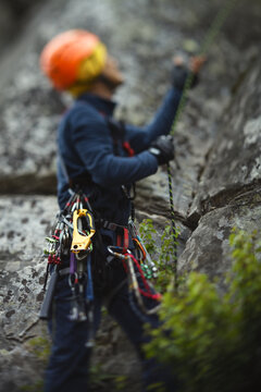 Abstract blurred image of a figure of a climber and climbing equipment.