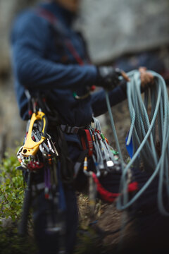 Abstract blurred image of a figure of a climber and climbing equipment, close-up.