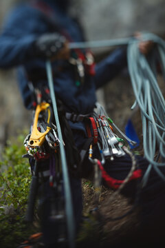 Climbing equipment on the belt climber, abstract blurred image, close-up.