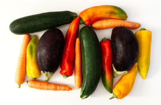 Mix of raw vegetables. Green Zucchini, Aubergine, Carrot, Pepper, isolated on white background. View from above