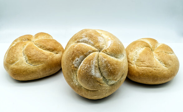 Fresh Kaiser rolls baked bread. Kaiser is a type of round, hard, and crunchy bread originally from Austria, often used to make sandwiches.