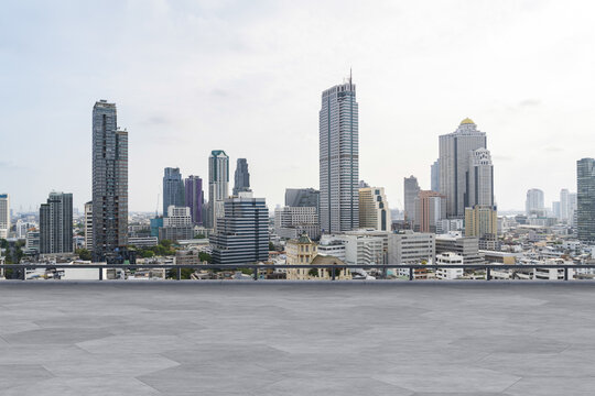 Panoramic Bangkok skyline view, concrete observatory deck on rooftop, daytime. Luxury Asian corporate and residential lifestyle. Financial city downtown, real estate. Product display mockup empty roof