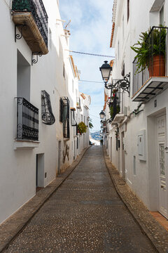 Traditional mediterranean architecture. Beautiful white houses in narrow street in Altea old town, Spain
